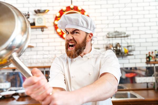 Louco louco chef cozinhar frigideira cozinha Foto stock © deandrobot