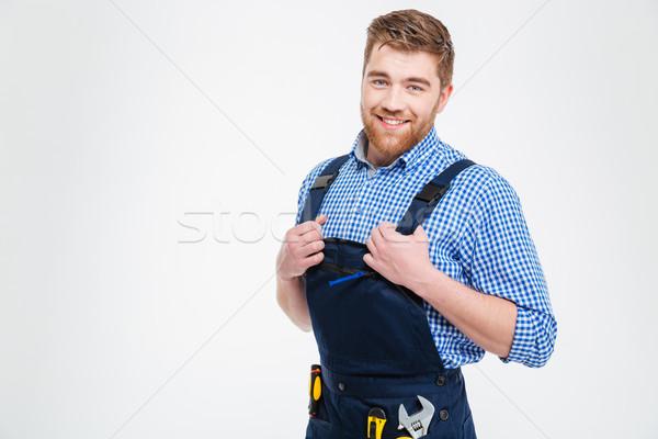 Portrait of a handsome male builder Stock photo © deandrobot