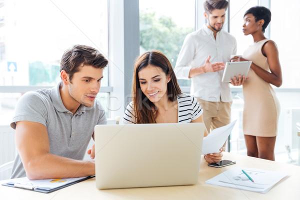 Mosolyog üzletemberek dolgozik laptop tabletta iroda Stock fotó © deandrobot
