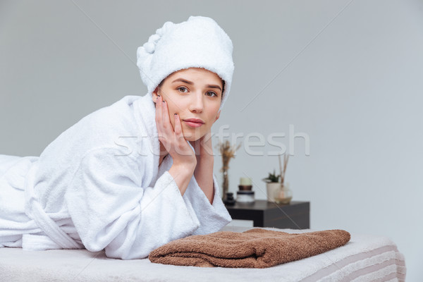 Attractive young woman relaxing in spa salon Stock photo © deandrobot