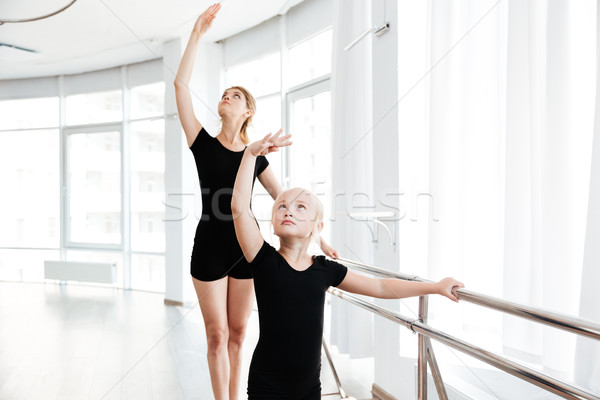 Little ballerina and teacher dancing tiptoes in dance studio Stock photo © deandrobot