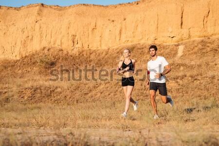 Adam kadın koşucuların egzersiz açık havada birlikte Stok fotoğraf © deandrobot