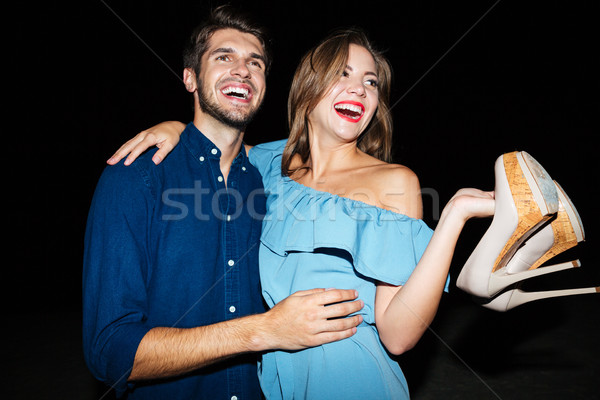 Cheerful young couple hugging and having fun at night Stock photo © deandrobot