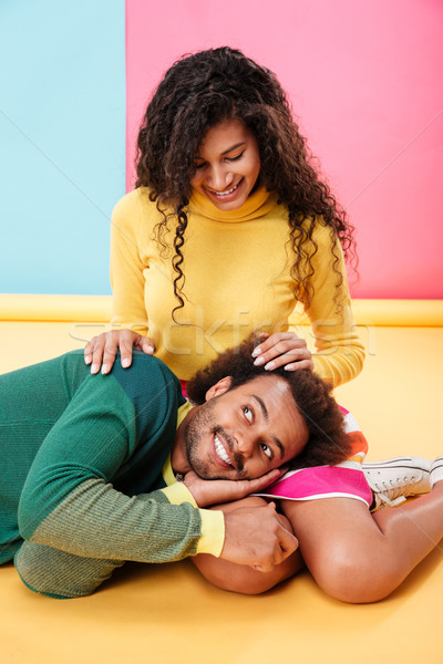 Happy tender african american young couple relaxing together Stock photo © deandrobot