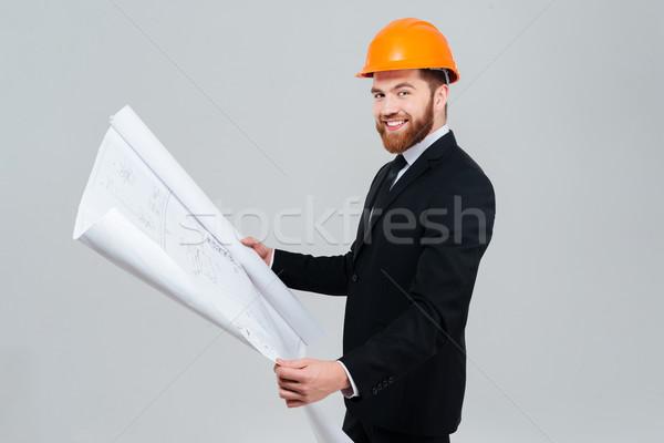 Widok z boku inżynier garnitur uśmiechnięty brodaty pomarańczowy Zdjęcia stock © deandrobot