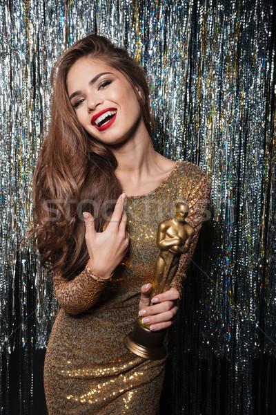 счастливым вечернее платье улыбаясь награда Сток-фото © deandrobot