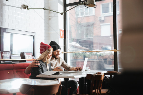 Side view of young hipsters with laptop Stock photo © deandrobot
