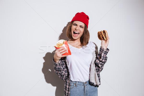 голодный Lady фри Burger Сток-фото © deandrobot