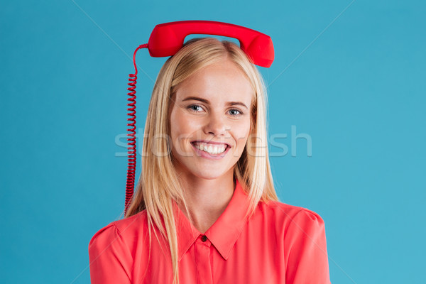 Smiling happy blonde woman with red tube on her head Stock photo © deandrobot