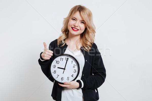 Glimlachend toevallig meisje tiener klok Stockfoto © deandrobot