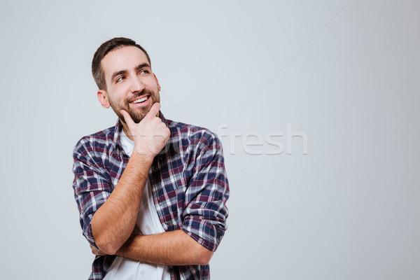 Smiling pensive Bearded man in shirt Stock photo © deandrobot
