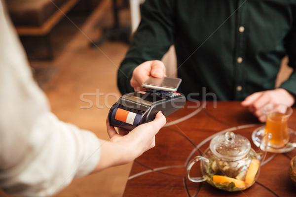 Imagem surpreendente moço ordem sessão café Foto stock © deandrobot