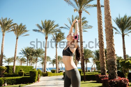 Cheerful carefree woman standing and having fun on summer resort Stock photo © deandrobot