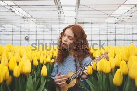 Shot of lying on flowers woman Stock photo © deandrobot