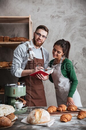 Vertical image of bakers in bakery Stock photo © deandrobot