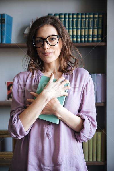 Portre gülen olgun kadın gözlük kitap Stok fotoğraf © deandrobot