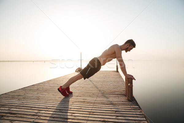 молодым человеком спортсмена улице пляж утра Сток-фото © deandrobot