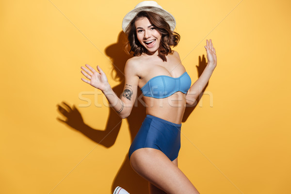 Happy young woman in swimwear Stock photo © deandrobot