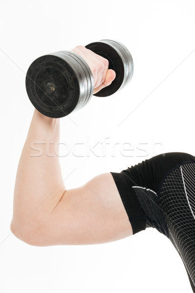 Cropped photo of strong sportsman make sports exercises with dumbbell Stock photo © deandrobot