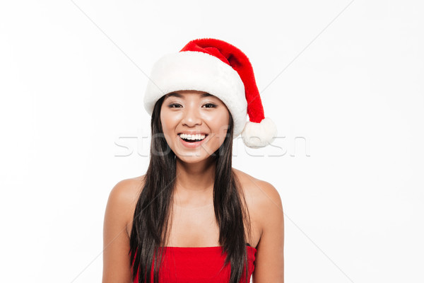 Close up portrait of an attractive happy young asian woman Stock photo © deandrobot