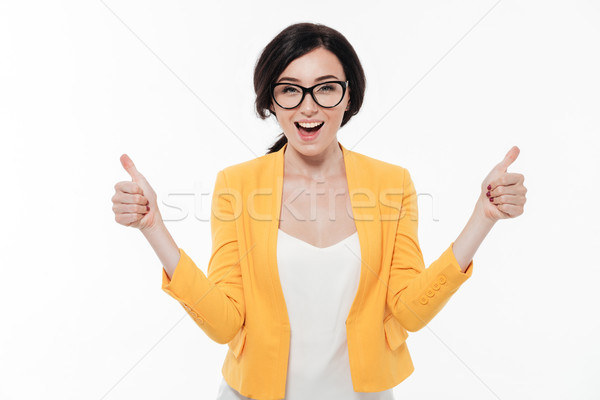Portrait of a happy woman in eyeglasses and a jacket Stock photo © deandrobot