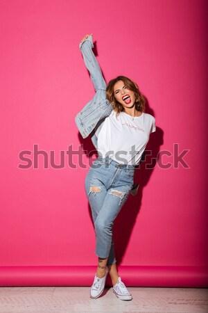 Full-length image of happy brunette woman rejoice and holding money Stock photo © deandrobot