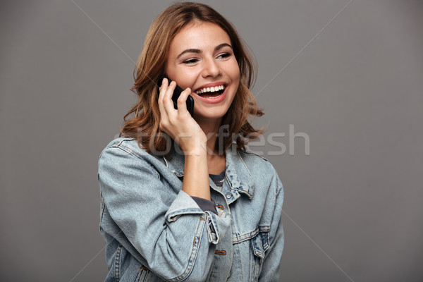 Close up portrait of a cheery pretty teenage girl Stock photo © deandrobot
