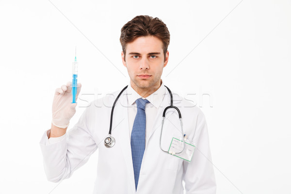 Close up portrait of a focused young male doctor Stock photo © deandrobot