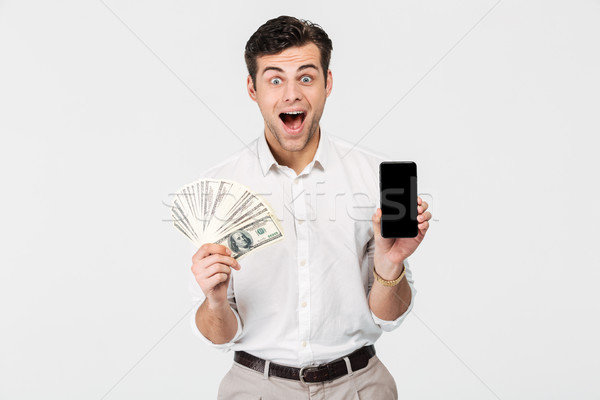 Portrait of a smiling excited man Stock photo © deandrobot