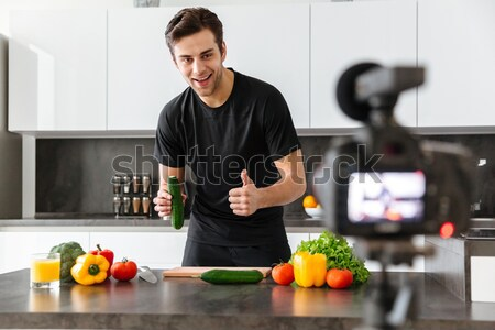 Haooy young man filming his video blog episode Stock photo © deandrobot