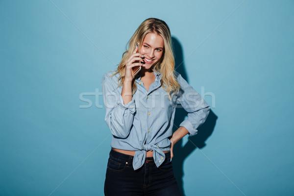 Gülen sarışın kadın gömlek konuşma Stok fotoğraf © deandrobot