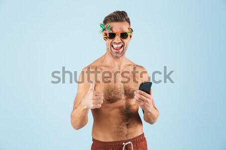 Stockfoto: Glimlachend · jonge · man · tonen · okay · gebaar · afbeelding