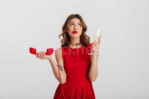 Retrato pensativo vestido rojo teléfono Foto stock © deandrobot