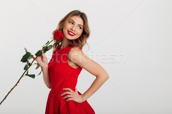 肖像 笑みを浮かべて 若い女性 赤いドレス バラ ストックフォト © deandrobot