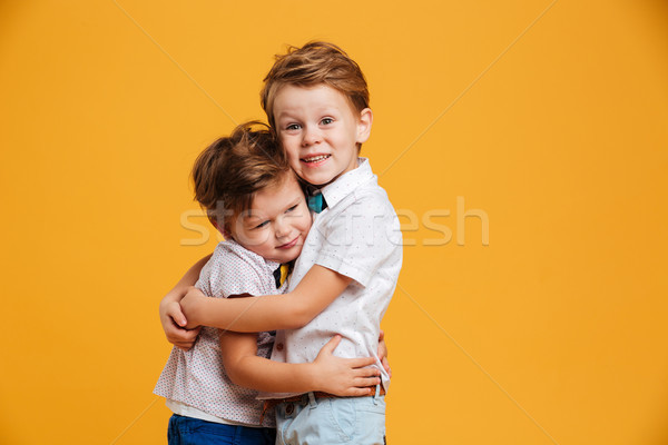 Happy little children brothers isolated Stock photo © deandrobot