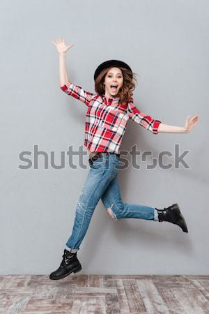 Full length portrait of a young girl in plaid shirt Stock photo © deandrobot