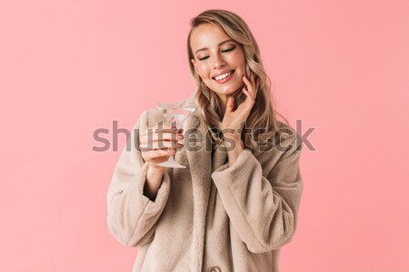 Portrait of a lovely smiling woman posing with eyes closed Stock photo © deandrobot