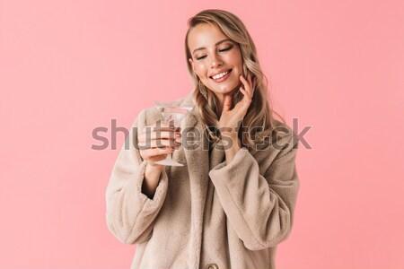 Portre gülümseyen kadın poz gözleri kapalı yalıtılmış pembe Stok fotoğraf © deandrobot