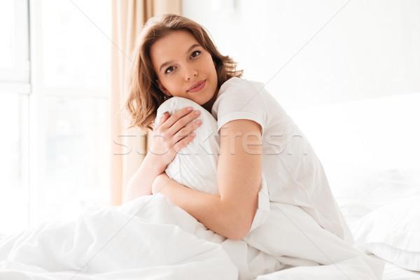 şaşırtıcı genç kadın yatak yastık Stok fotoğraf © deandrobot