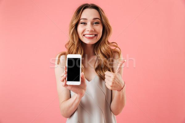 Felice bruna donna pigiama smartphone Foto d'archivio © deandrobot