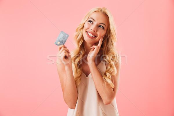 Foto stock: Pensativo · mulher · loira · vestir · cartão · de · crédito