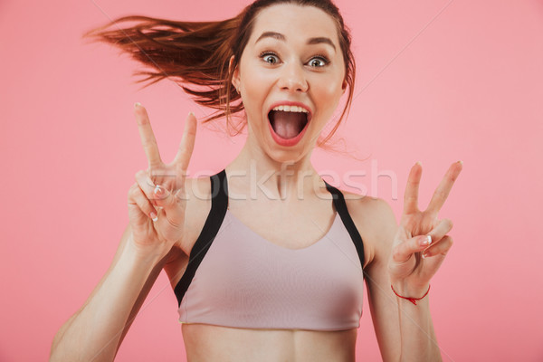 Excited young fitness sports woman running Stock photo © deandrobot
