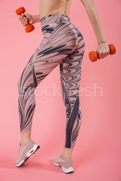 Cropped image of amazing young fitness sports woman Stock photo © deandrobot