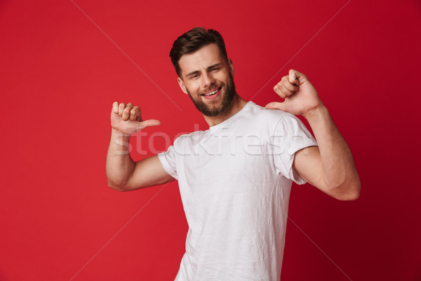 Excited young handsome man pointing to himself. Stock photo © deandrobot