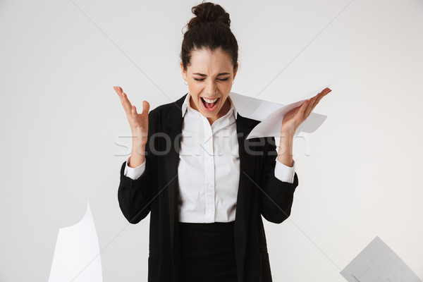 Portrait of an angry young businesswoman screaming Stock photo © deandrobot