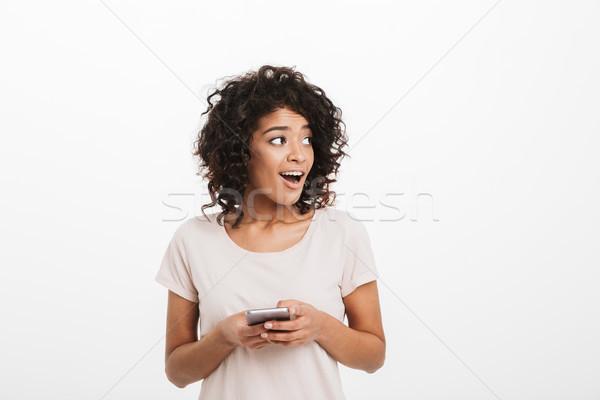 содержание брюнетка женщину афро прическа смартфон Сток-фото © deandrobot