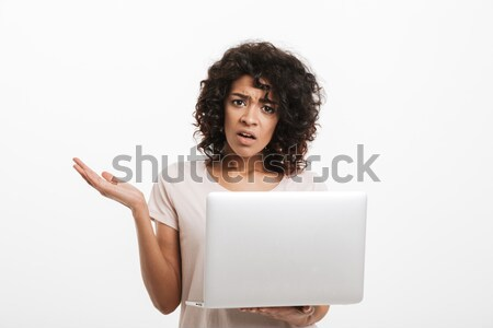 Portrait of confused young afro american woman Stock photo © deandrobot
