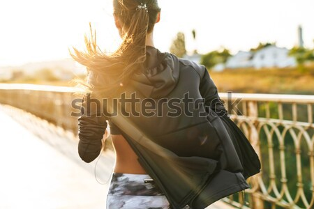 Image of disabled running woman in sportswear, doing slopes and  Stock photo © deandrobot
