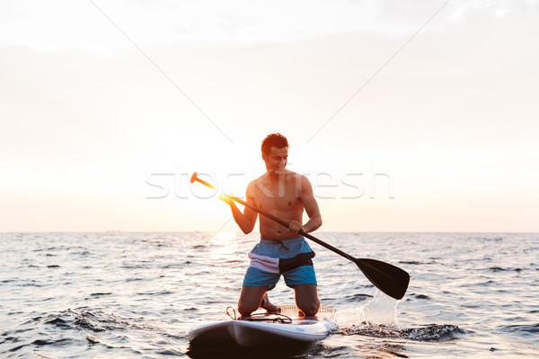 красивый мужчина озеро морем изображение молодые Сток-фото © deandrobot