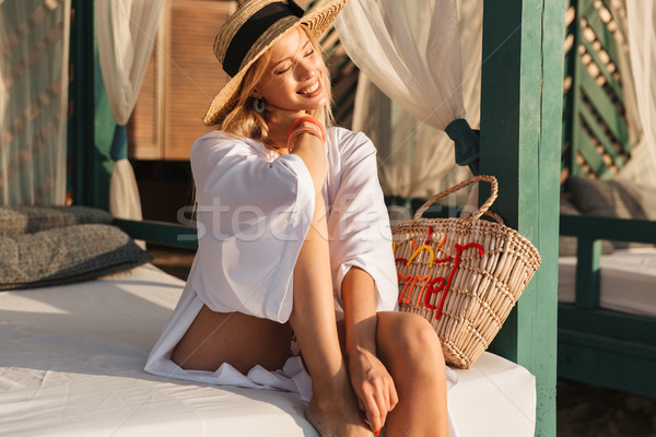 Smiling young girl in summer hat and swimwear resting Stock photo © deandrobot